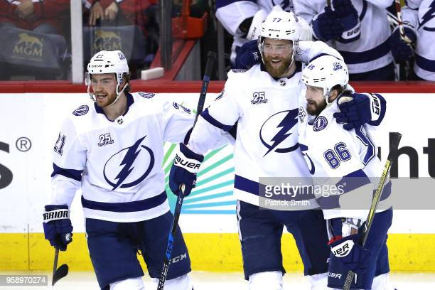 Nikita Kucherov of the Tampa Bay Lightning celebrates with teammate Victor  Hedman and Brayden Point after 72454f35f9ee
