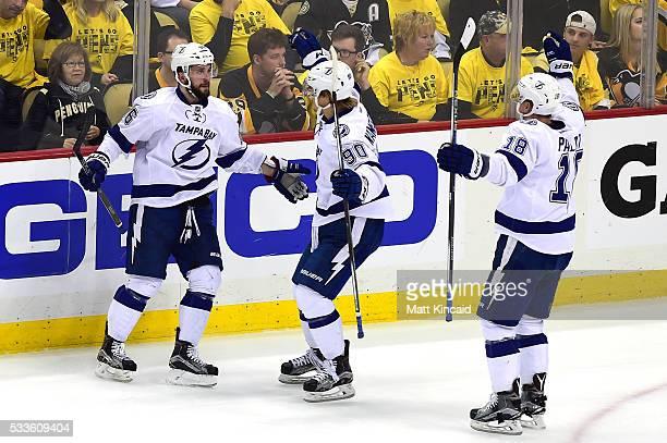 Nikita Kucherov of the Tampa Bay Lightning celebrates with teammates Vladislav Namestnikov and Ondrej Palat after scoring a goal against MarcAndre...