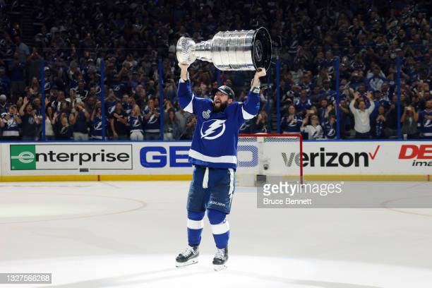 Nikita Kucherov of the Tampa Bay Lightning celebrates with the Stanley Cup after the 1-0 victory against the Montreal Canadiens in Game Five to win...