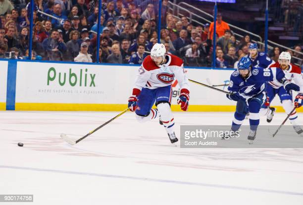 Nikita Kucherov of the Tampa Bay Lightning chases Alex Galchenyuk of the Montreal Canadiens during overtime at Amalie Arena on March 10 2018 in Tampa...