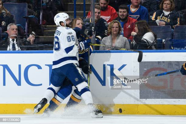 Nikita Kucherov of the Tampa Bay Lightning checks Alexander Steen of the St Louis Blues at Scottrade Center on December 12 2017 in St Louis Missouri
