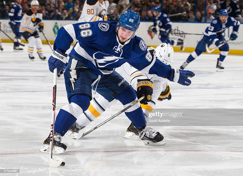 Nikita Kucherov #86 of the Tampa Bay Lightning controls the puck against Mike Weber #6 of the Buffalo Sabres during the third period at the Tampa Bay Times Forum on March 6, 2014 in Tampa, Florida.