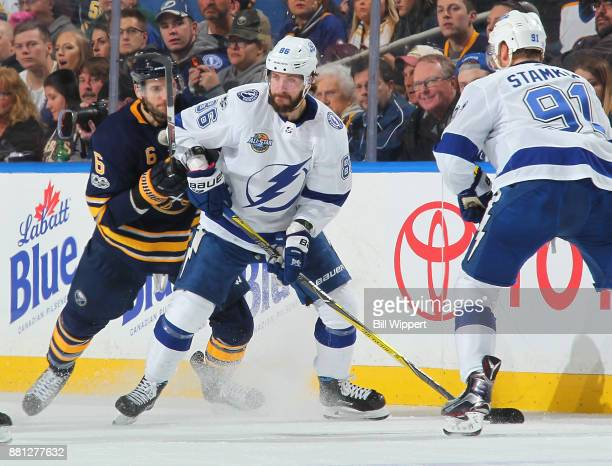 Nikita Kucherov of the Tampa Bay Lightning controls the puck against Marco Scandella of the Buffalo Sabres during an NHL game on November 28 2017 at...
