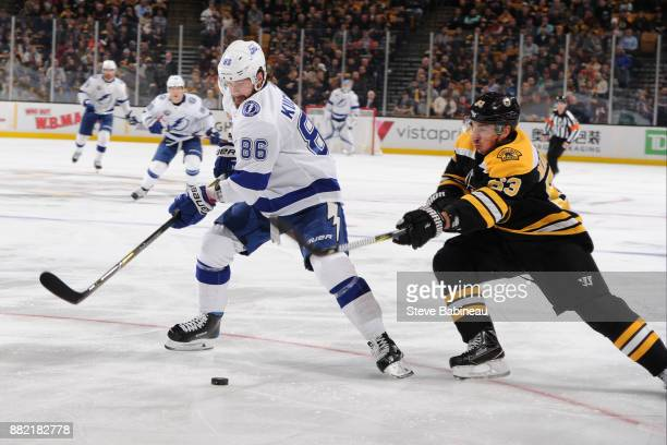 Nikita Kucherov of the Tampa Bay Lightning fights for the puck against Brad Marchand of the Boston Bruins at the TD Garden on November 29 2017 in...