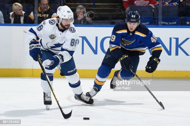 Nikita Kucherov of the Tampa Bay Lightning handles the puck as Ivan Barbashev of the St Louis Blues pressures at Scottrade Center on December 12 2017...
