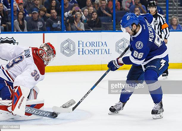 Nikita Kucherov of the Tampa Bay Lightning has his shot saved by goalie Mike Condon of the Montreal Canadiens during the shoot out at the Amalie...