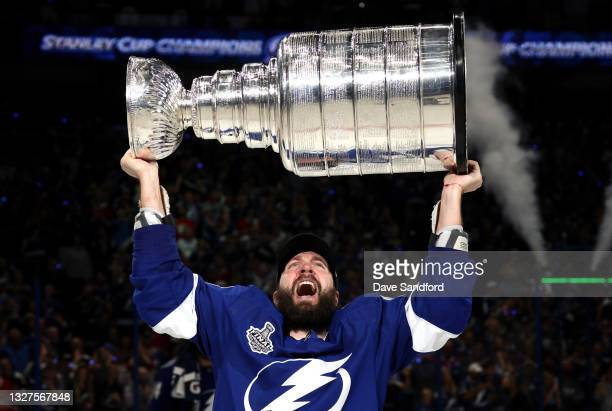 Nikita Kucherov of the Tampa Bay Lightning hoists the Stanley Cup after their 1-0 win in Game Five of the 2021 Stanley Cup Final to win the series...
