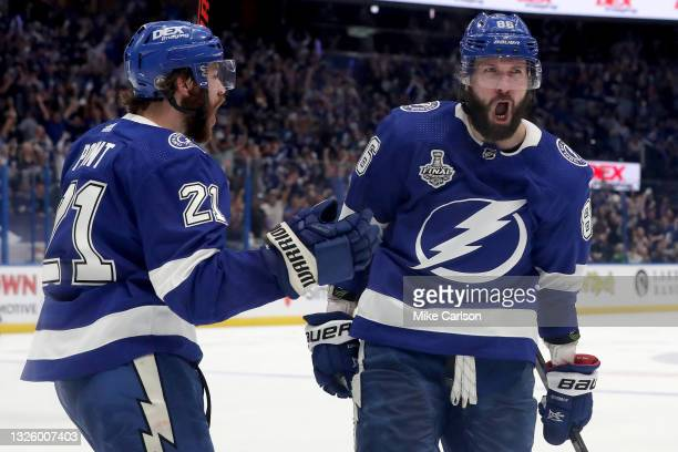 Nikita Kucherov of the Tampa Bay Lightning is congratulated by Brayden Point after scoring a goal against the Montreal Canadiens during the third...