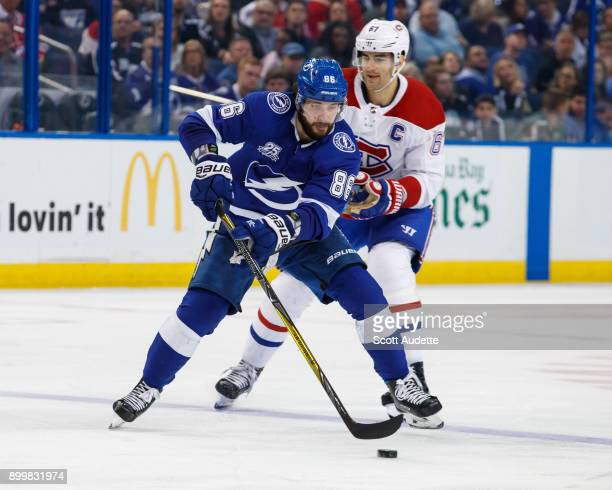 Nikita Kucherov of the Tampa Bay Lightning is hooked by Max Pacioretty of the Montreal Canadiens during the third period at Amalie Arena on December...