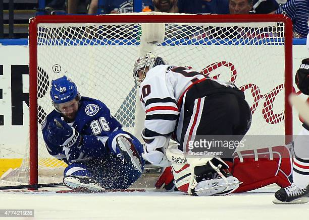 Nikita Kucherov of the Tampa Bay Lightning is injured as he hits the goal post while skating in on Corey Crawford of the Chicago Blackhawks during...
