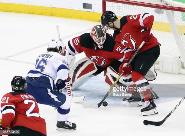 Nikita Kucherov of the Tampa Bay Lightning moves in on Cory Schneider of the New Jersey Devils of the Eastern Conference First Round during the 2018...