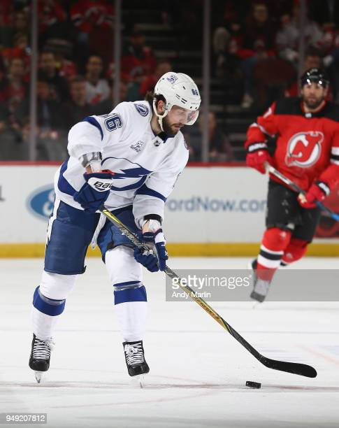 Nikita Kucherov of the Tampa Bay Lightning plays the puck against the New Jersey Devils in Game Four of the Eastern Conference First Round during the...