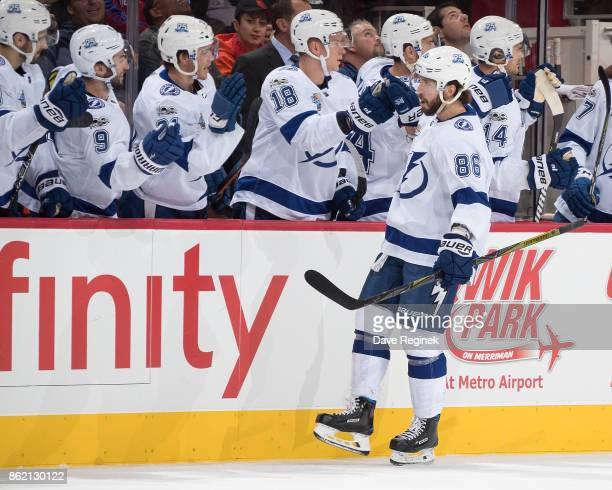 Nikita Kucherov of the Tampa Bay Lightning pounds gloves with teammates on the bench following his first period goal during an NHL game against the...