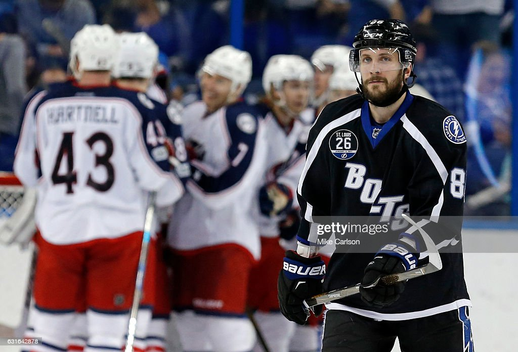 Nikita Kucherov #86 of the Tampa Bay Lightning reacts as members of the Columbus Blue Jackets celebrate a win at the Amalie Arena on January 13, 2017 in Tampa, Florida.