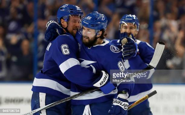 Nikita Kucherov of the Tampa Bay Lightning right celebrates a goal against the New Jersey Devils with Anton Stralman in the third period of Game Five...