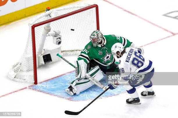 Nikita Kucherov of the Tampa Bay Lightning scores a goal past Anton Khudobin of the Dallas Stars during the first period in Game Three of the 2020...