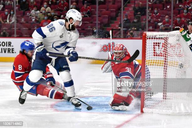 Nikita Kucherov of the Tampa Bay Lightning scores against Carey Price of the Montreal Canadiens during the second period in Game Three of the 2021...