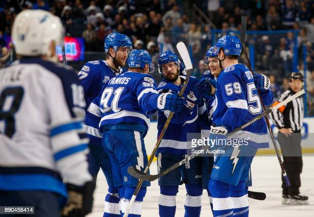 Nikita Kucherov of the Tampa Bay Lightning scores against the Winnipeg Jets during the third period at Amalie Arena on December 9 2017 in Tampa...