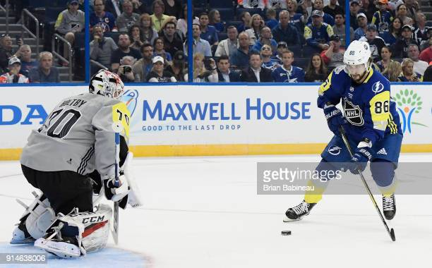 Nikita Kucherov of the Tampa Bay Lightning scores his third goal for a hat trick against goaltender Braden Holtby of the Washington Capitals during...