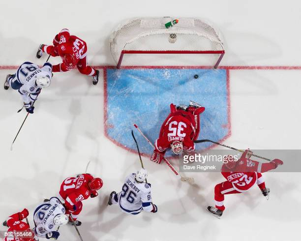 Nikita Kucherov of the Tampa Bay Lightning scores that game winning goal on Jimmy Howard of the Detroit Red Wings during an NHL game at Little...