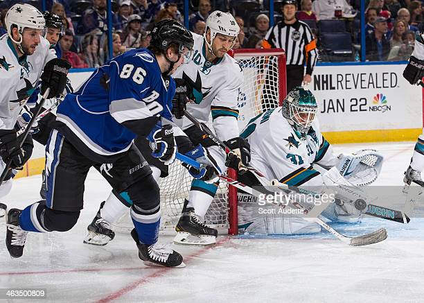 Nikita Kucherov of the Tampa Bay Lightning shoots the puck against goalie Antti Niemi and Andrew Desjardins of the San Jose Sharks during the first...