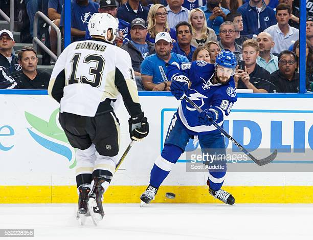 Nikita Kucherov of the Tampa Bay Lightning shoots the puck against Nick Bonino of the Pittsburgh Penguins during the first period of Game Three of...