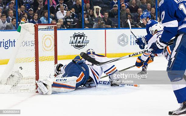 Nikita Kucherov of the Tampa Bay Lightning shoots the puck into the net of goalie Anders Nilsson of the Edmonton Oilers during the first period at...