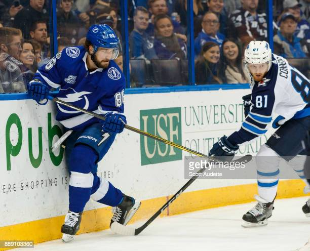 Nikita Kucherov of the Tampa Bay Lightning skates against Kyle Connor of the Winnipeg Jets during the first period at Amalie Arena on December 9 2017...