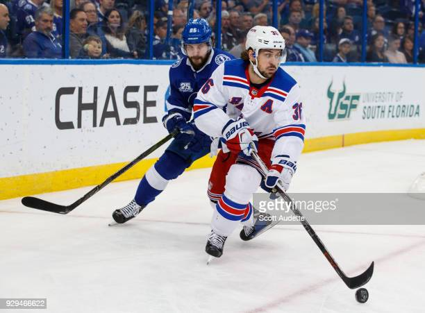 Nikita Kucherov of the Tampa Bay Lightning skates against Mats Zuccarello of the New York Rangers during the third period at Amalie Arena on March 8...