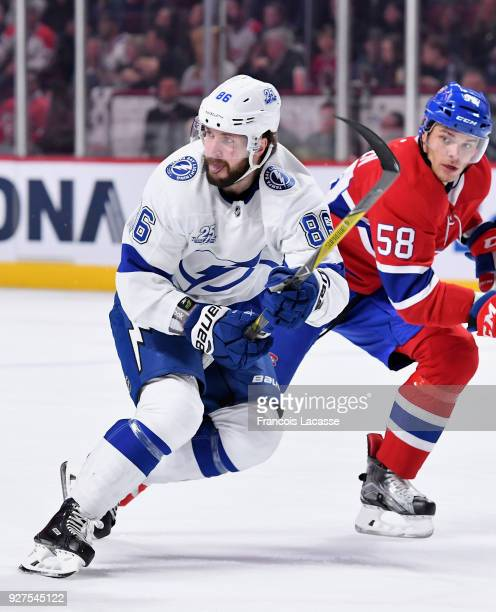 Nikita Kucherov of the Tampa Bay Lightning skates against Noah Juulsen of the Montreal Canadiens in the NHL game at the Bell Centre on February 24...