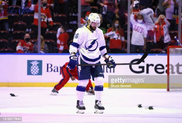 Nikita Kucherov of the Tampa Bay Lightning skates back to the bench amongst plastic rats littering the ice following a third period goal by Owen...
