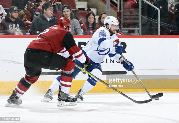 Nikita Kucherov of the Tampa Bay Lightning skates with the puck as Luke Schenn of the Arizona Coyotes defends during the third period at Gila River...