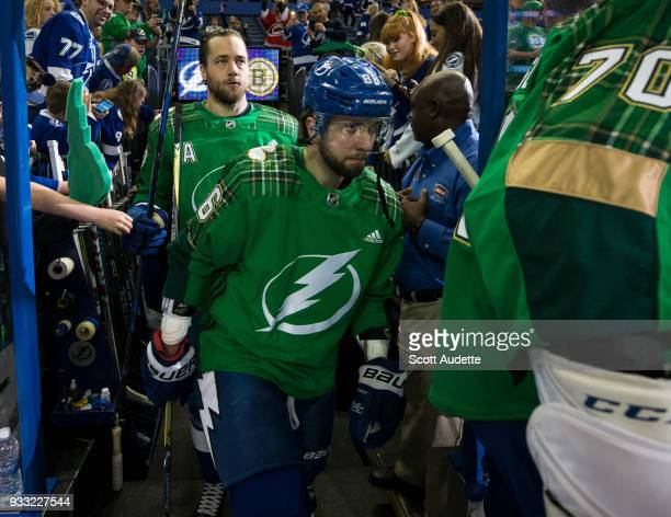 Nikita Kucherov of the Tampa Bay Lightning sports a green warmup jersey for St Patrick's Day during pregame warm ups against the Boston Bruins at...