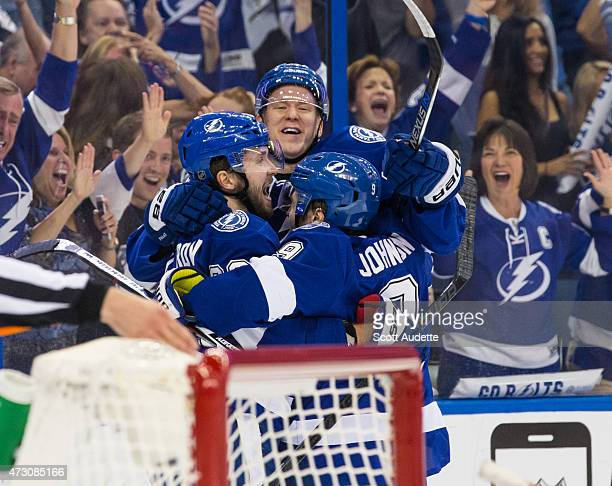 Nikita Kucherov Ondrej Palat and Tyler Johnson of the Tampa Bay Lightning celebrate a goal against the Montreal Canadiens during the first period in...