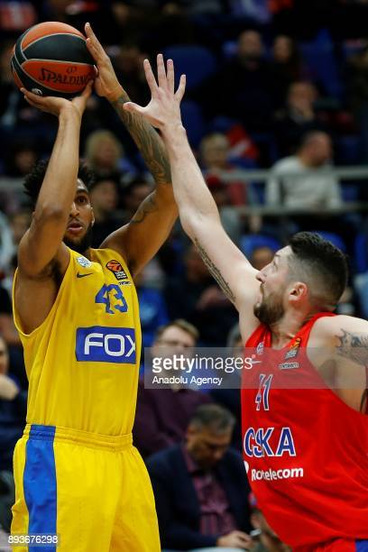 Nikita Kurbanov of CSKA Moscow vies with Jonah Bolden of Maccabi Fox during the Turkish Airlines Euroleague match between CSKA Moscow and Maccabi Fox...