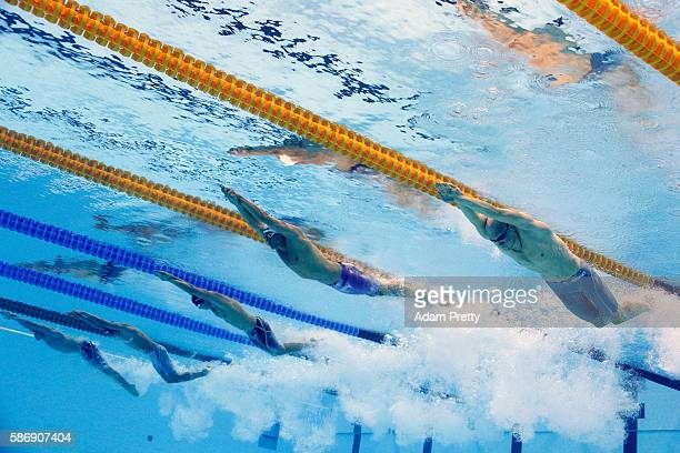 Nikita Lobintsev of Russia Welson Sim of Malaysia Andrea D'Arrigo of Italy and Federico Grabich of Argentina compete in the Men's 200m Freestyle heat...