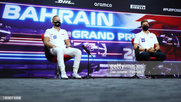 Nikita Mazepin of Russia and Haas F1 and Mick Schumacher of Germany and Haas F1 talk in the Drivers Press Conference during previews ahead of the F1...