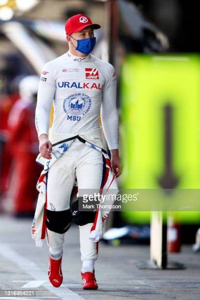 Nikita Mazepin of Russia and Haas F1 walks in the Pitlane during qualifying for the F1 Grand Prix of Spain at Circuit de Barcelona-Catalunya on May...