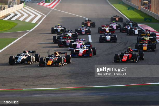 Nikita Mazepin of Russia and Hitech Grand Prix leads Yuki Tsunoda of Japan and Carlin into turn one at the start during the Round 12:Sakhir Feature...