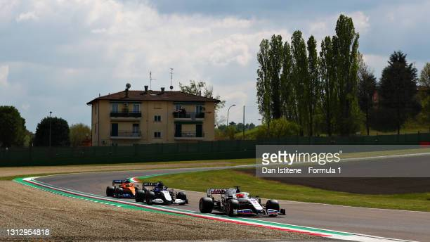 Nikita Mazepin of Russia driving the Haas F1 Team VF-21 Ferrari, George Russell of Great Britain driving the Williams Racing FW43B Mercedes and...