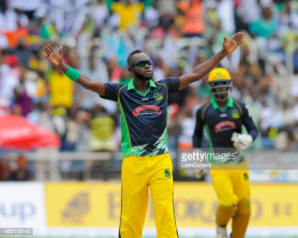 Nikita Miller of Jamaica Tallawahs celebrates the dismissal of Neil McKenzie of Barbados Tridents during a match between Jamaica Tallawahs and...