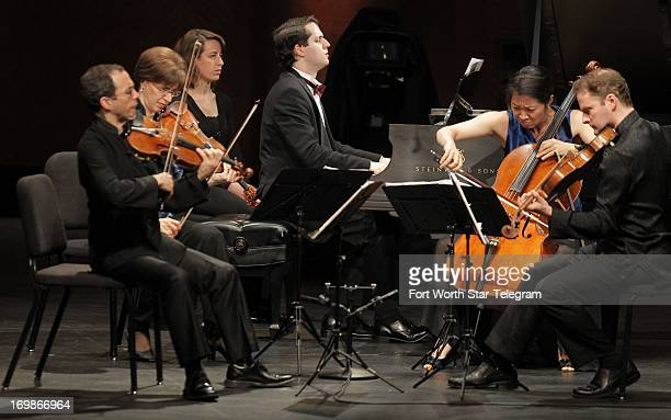 Nikita Mndoyants of Russia performs with the Brentano String Quartet during the Van Cliburn International Piano Competition at Bass Performance Hall...