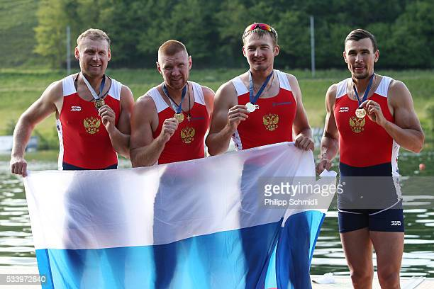 Nikita Morgachev Artem Kosov Vladislav Ryabcev and Sergey Fedorovtsev of Russia pose for a photo after qualifying for the 2016 Summer Olympic Games...