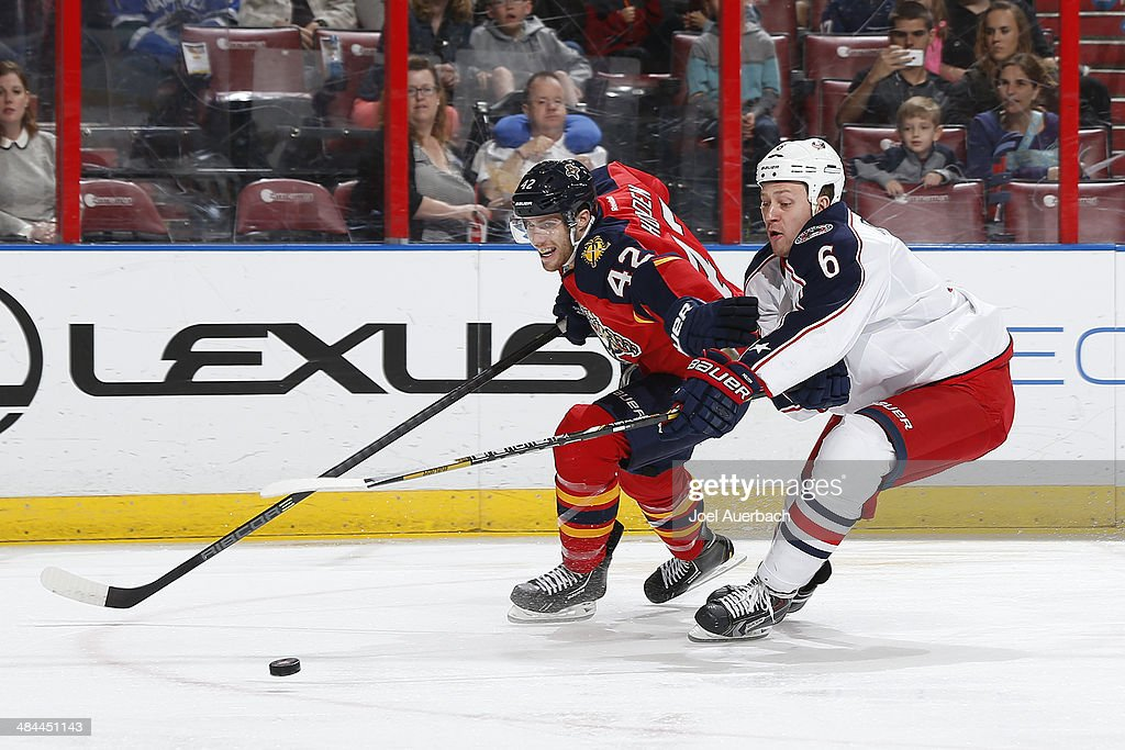 Nikita Nikitin #6 of the Columbus Blue Jackets attempts to check the puck away from Quinton Howden #42 of the Florida Panthers at the BB&T Center on April 12, 2014 in Sunrise, Florida.