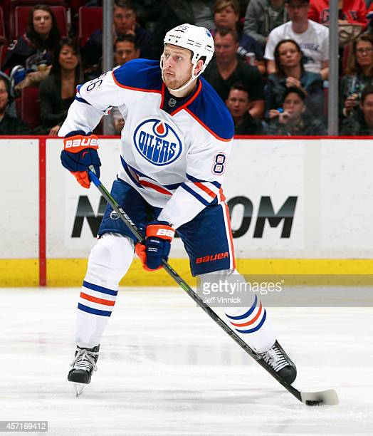 Nikita Nikitin of the Edmonton Oilers skates up ice with the puck during their NHL game against the Vancouver Canucks at Rogers Arena October 11,...