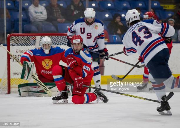 Nikita Okhotyuk of the Russian Nationals goes down to block a shot from Jack Hughes of the USA Nationals during the 2018 Under18 Five Nations...