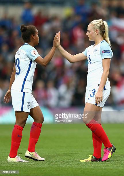 Nikita Parris and Alex Greenwood of England congratulate each other after the UEFA Women's European Championship Qualifying match between England and...