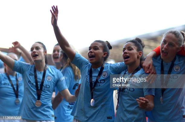 Nikita Parris Demi Stokes Janine Beckie and Tessa Wullaert of Manchester City celebrate winning the Continental League Cup Final between Arsenal...