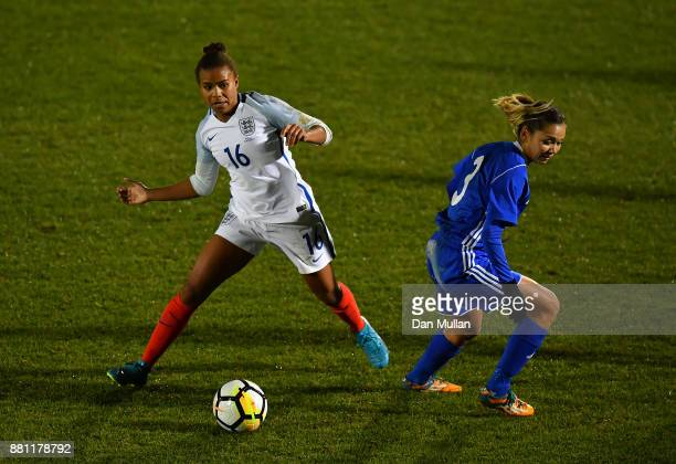 Nikita Parris of England battles for the ball with Aida Gaistenova of Kazakhstan during the FIFA Women's World Cup Qualifier between England and...