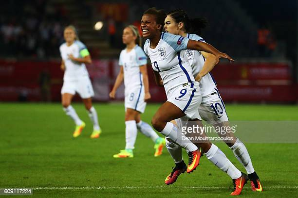 Nikita Parris of England celebrates scoring her teams first goal of the game with Karen Carney during the UEFA Women's Euro 2017 Qualifier between...